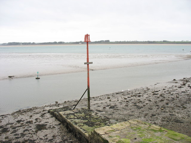 Low tide reveals the normally underwater part of the jetty