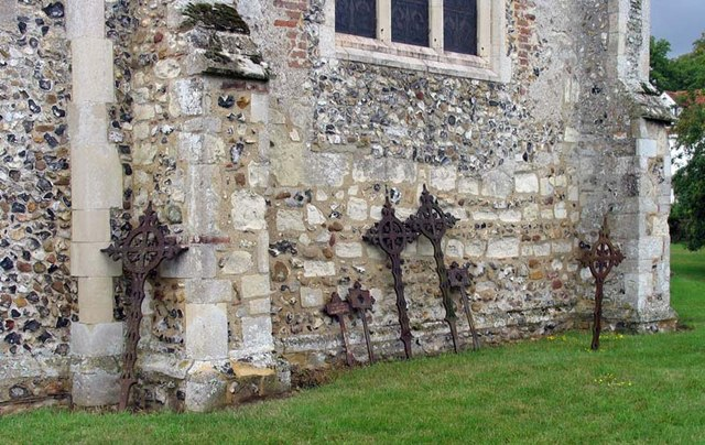 St Andrew, Buckland, Herts - Iron crosses in churchyard