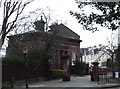 SJ3985 : Lodge at entrance to Grassendale Park by Tom Pennington