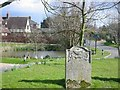 TL1778 : Upton village and pond from the churchyard by Chris Stafford