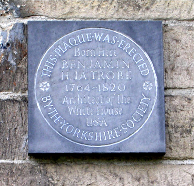 Plaque on wall of No 34 Fulneck