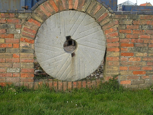 Mill Stone in a Wall