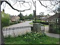 TG2917 : View of St Mary's Close from Wroxham churchyard by Nick Smith