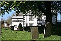 SX3173 : Churchyard and Pub by Tony Atkin