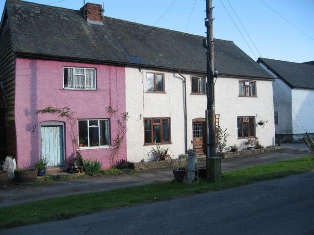 Rendered timber-frame cottages