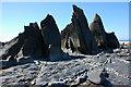 SS1911 : Rocks on Warren Gutter Beach by Philip Halling