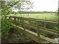 SP8216 : Footbridge over River Thame by David Hawgood