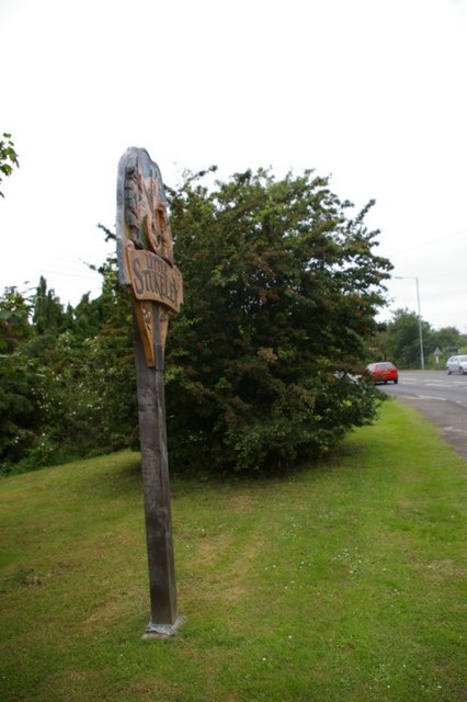 Village sign and verge