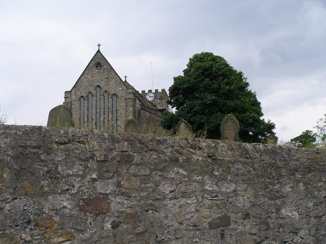The church wall with the church beyond