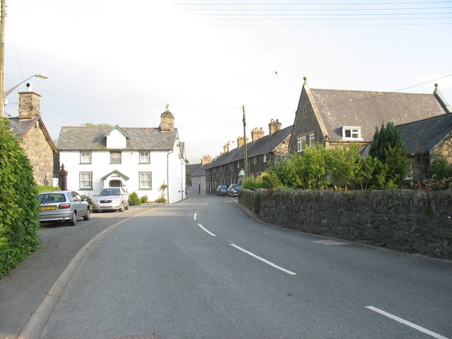 The main street of Llanuwchllyn with the old schoolhouse on the left