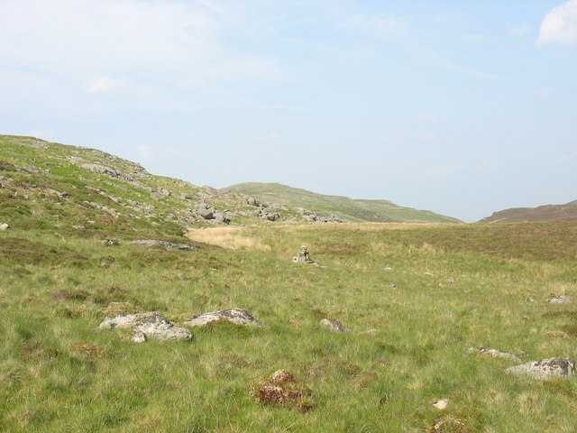 Cairn marking the path between the bouldery slopes of Cerrig yr Iwrch and Y Fign marsh