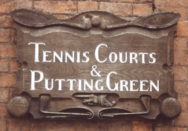 Carved wooden sign on street corner, Ross-on-Wye