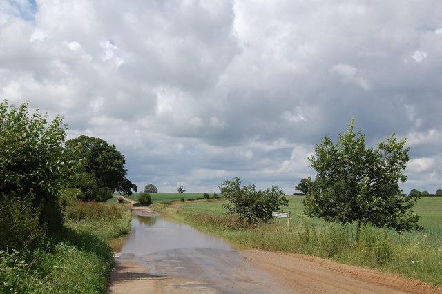 Flooded road near Dale Farm, Wantisden