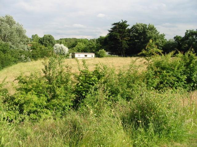 View across field to a caravan park