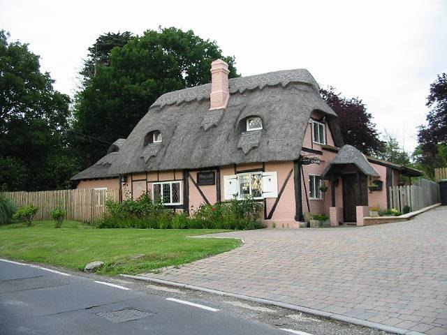 A pretty thatched cottage on Thornden Wood Road
