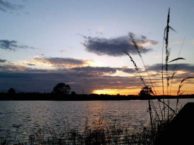 Sunset over temporary lake as a result of floods