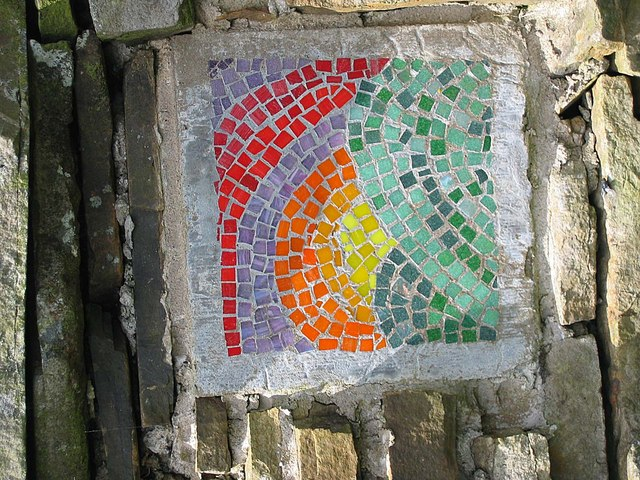 Mosaic set into dry stone wall at junction of Cam Road and Bands Lane