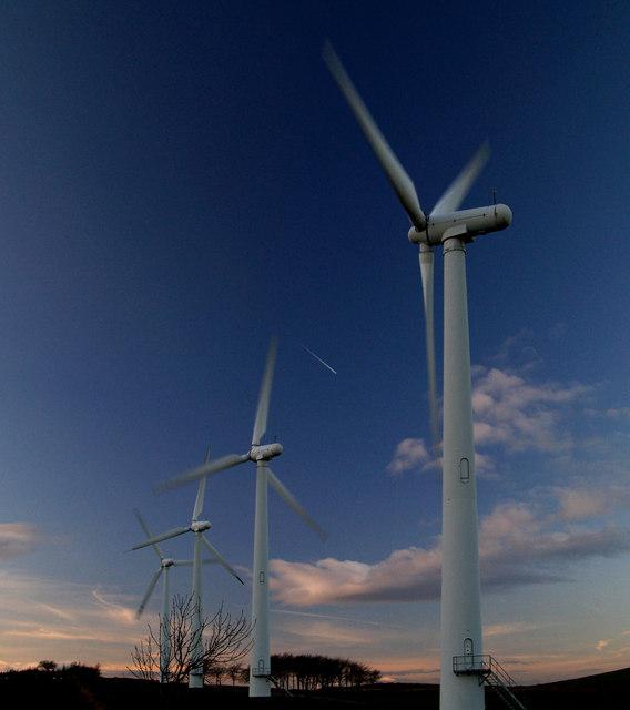Wind turbines against winter sunset