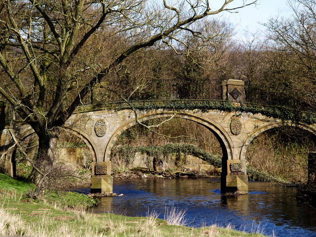 Bridge over infant River Dearne at Bretton country park