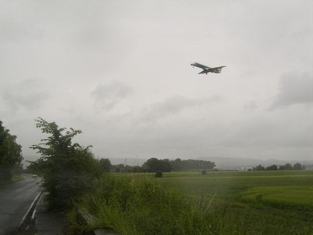 Plane landing over field