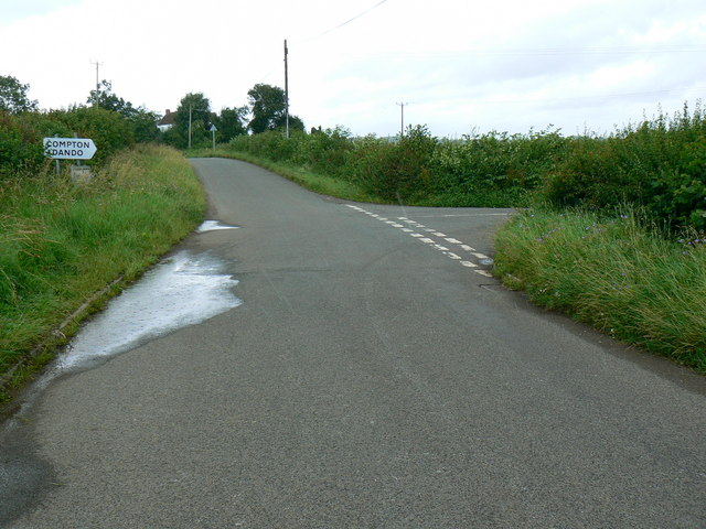 Road junction and rain, near Compton Common
