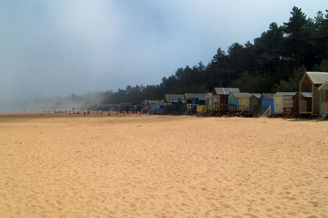 Beach huts Wells- next-the-Sea emerging from sea fret
