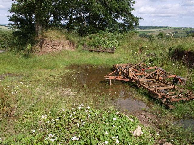 Farm machinery near Oak Cross