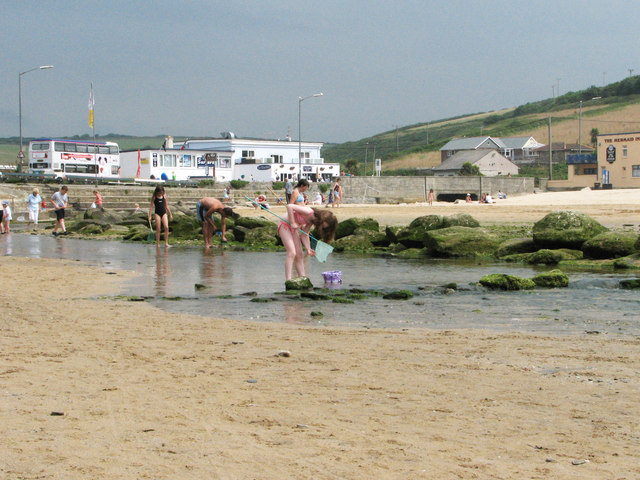 Fishing for tiddlers on Porth Beach