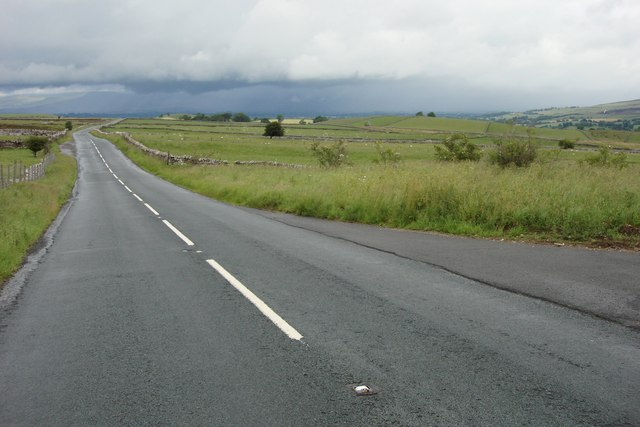 Looking north up the A683 towards a shower of rain over Kirkby Stephen!