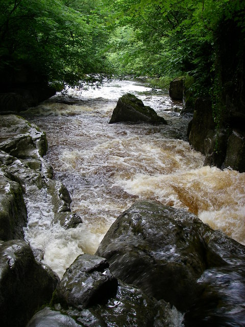 The Afon Mellte pours out of Porth yr Ogof