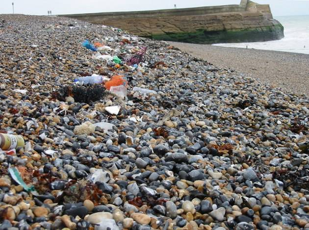Pebble beach with rubbish washed onshore