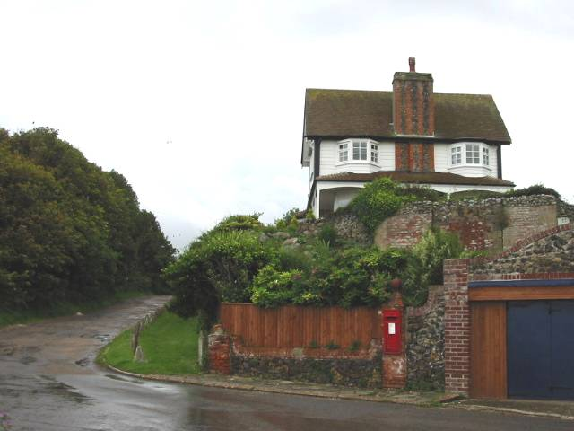 Oldstairs Road and a house on the hill