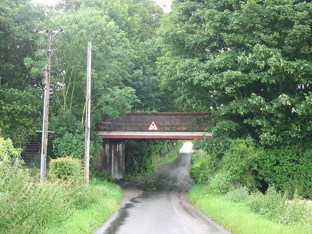 View along Sutton Lane under the railway bridge
