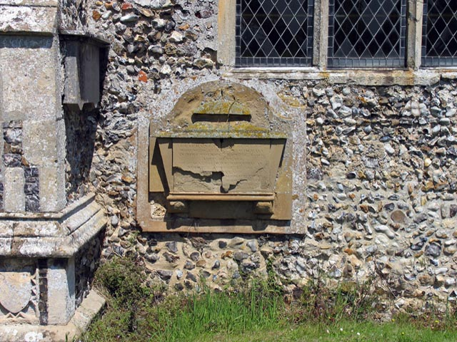 St Peter, Ringland, Norfolk - Exterior wall monument