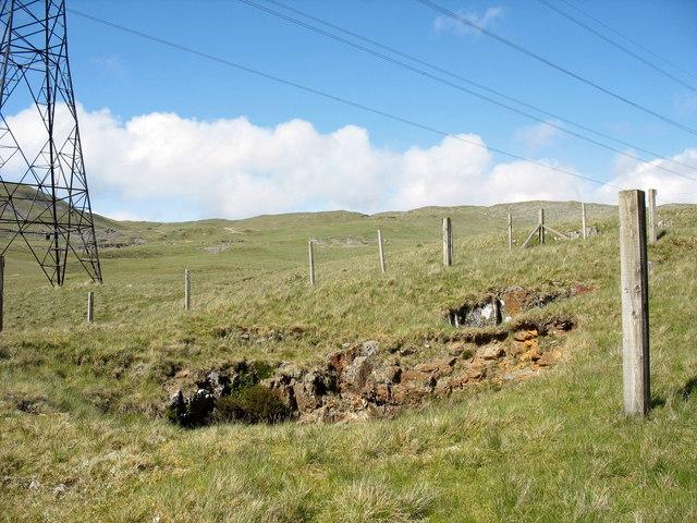 A fenced-off mine shaft alongside the Dolddinas-Dolbelydr track