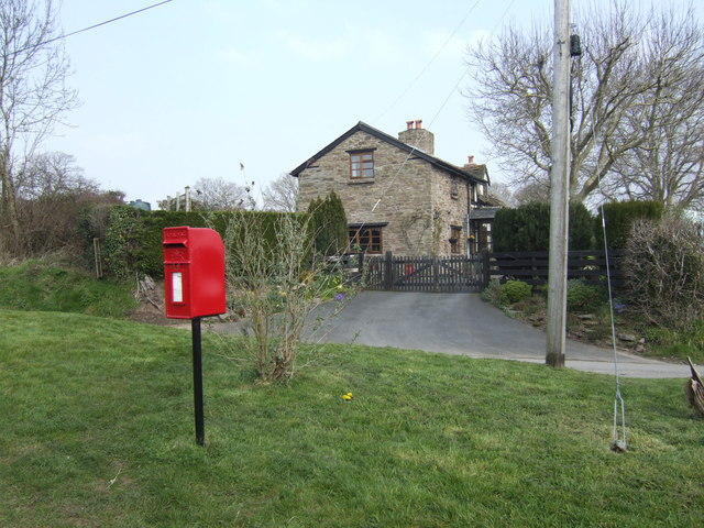 Post box and house in Lower Welson