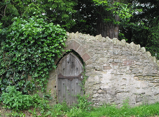Small door in old stone wall