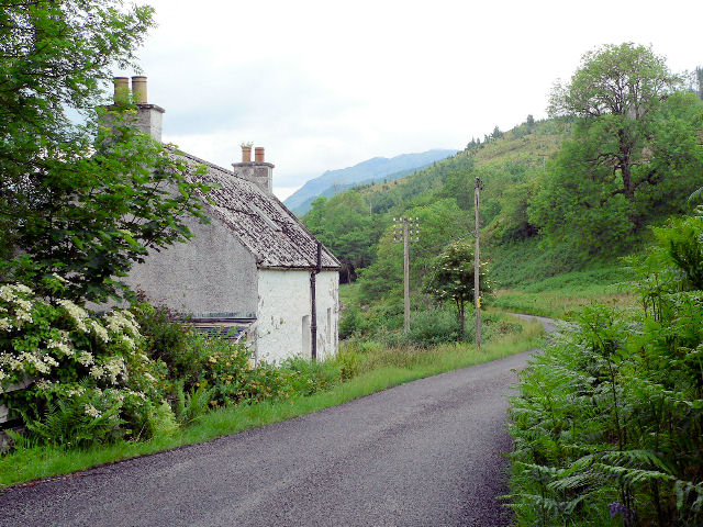 Cottage by road, on lochside