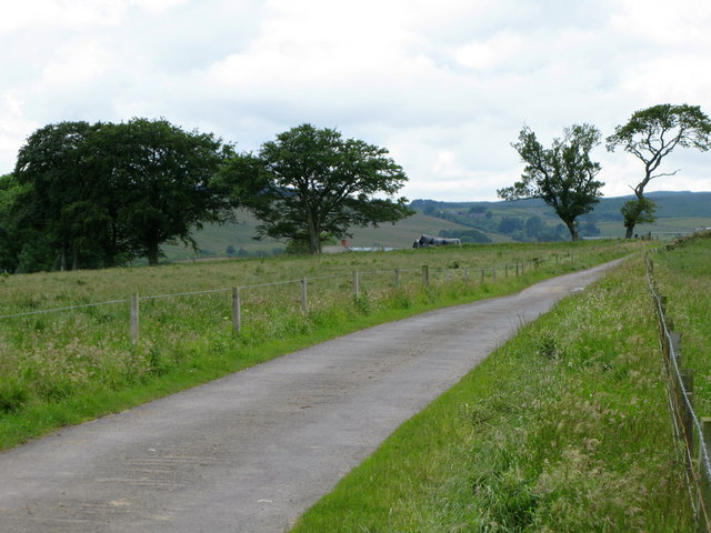 Minor road and meadows near Crossridge