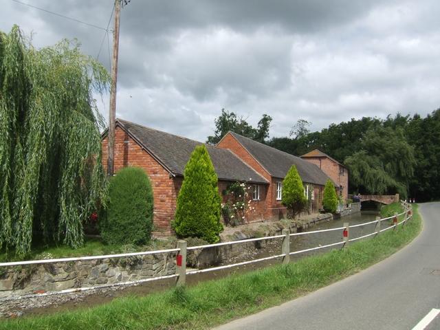 Converted barns alongside the Worthen Brook