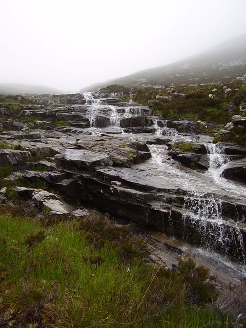 Waterfall cascading over rock slabs