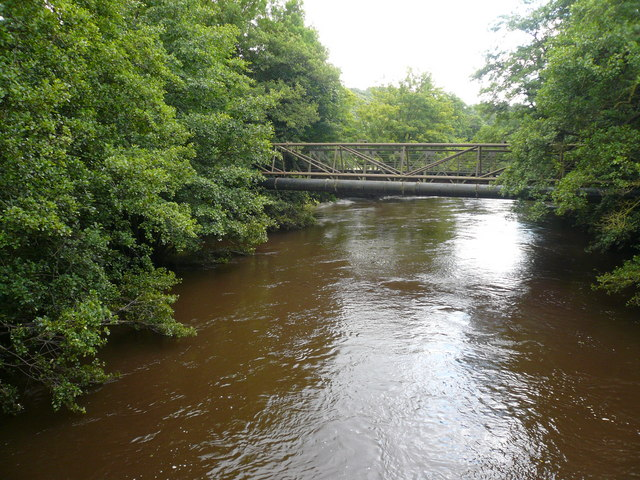 Footbridge crossing a flooded River Derwent