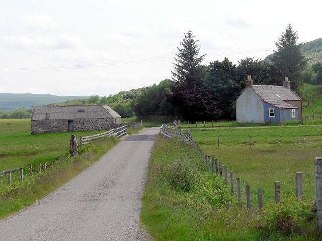 Farmhouse and barn by bridge