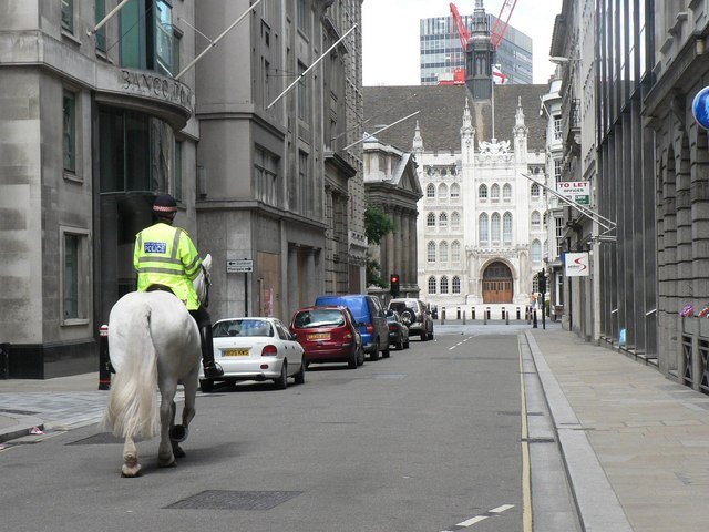 City of London: mounted policeman approaches the Guildhall