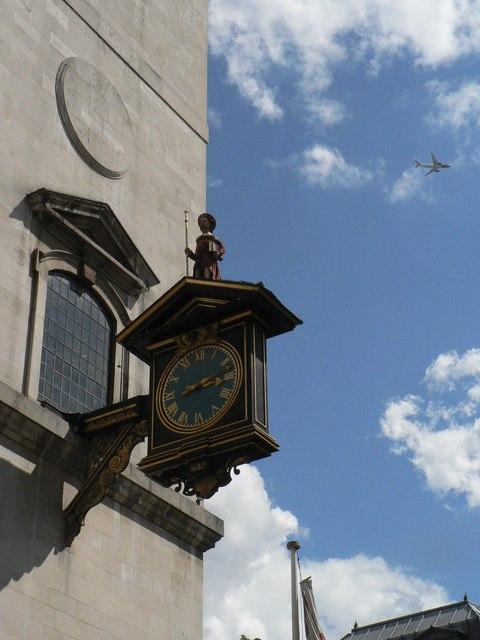 City of London: plane passes St. James Garlickhythe clock