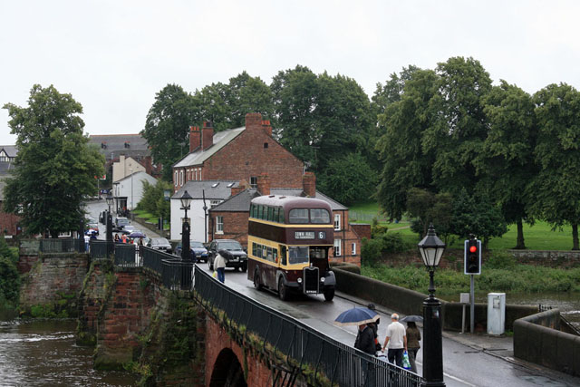 Historic bus on Old Dee Bridge in Chester