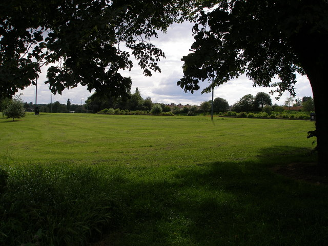 Open green space with footpath and cycleway