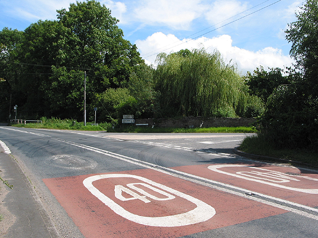 Road junction with speed limit reminders, Kilcot