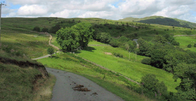 The Bedd y Coedwr road from the top of the hill