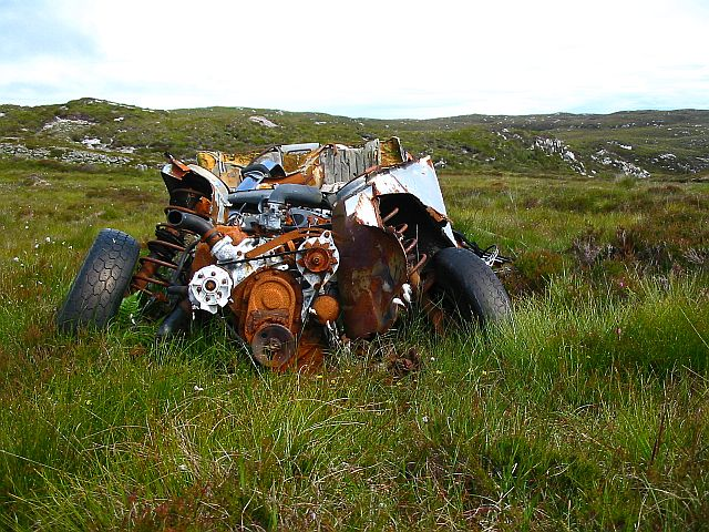 Wrecked car at end of the peat road